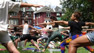 Group of people doing yoga in Malcolm X Park