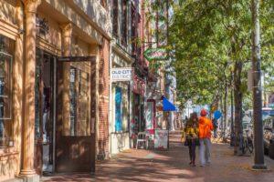 Pair of people walking down quaint city street
